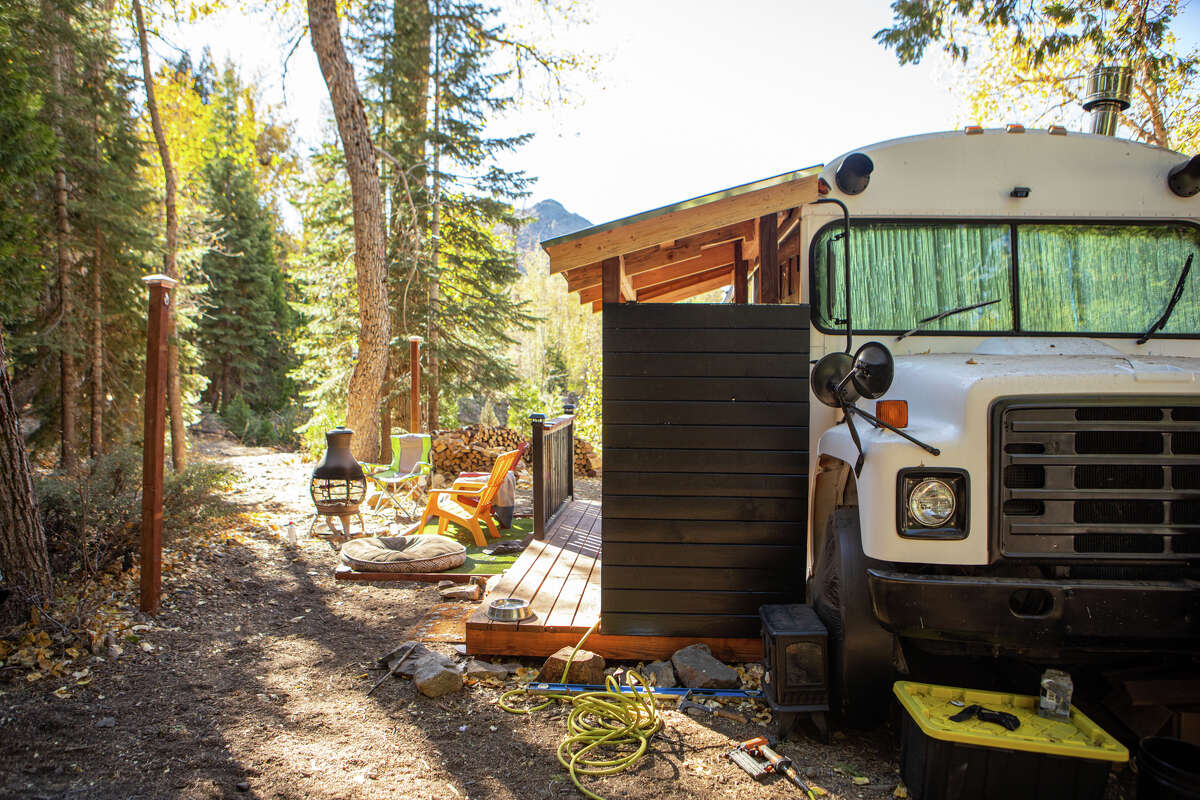 Occupants of the Cisco Grove Campground live in a wide variety of residences - from tiny homes to apartments and even refurbished school buses. This one has a recently finished porched, an addition that makes the resident feel a little more grounded.