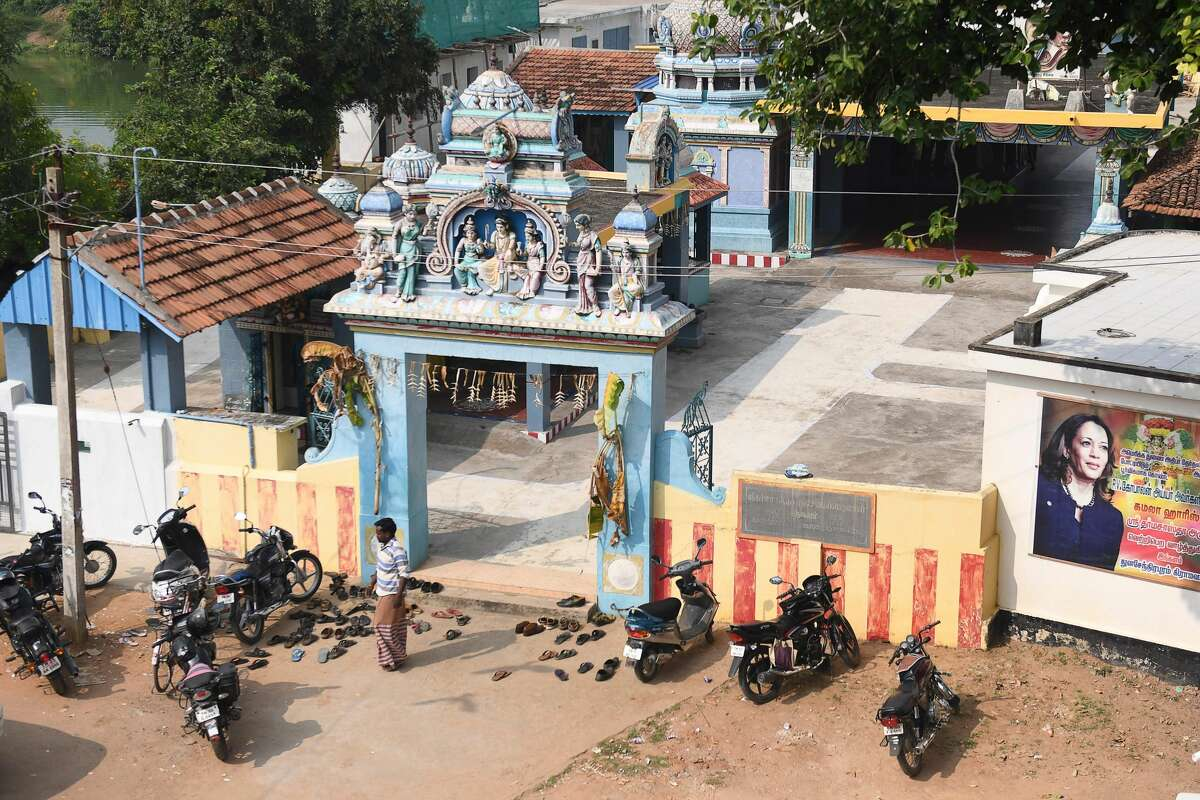 A poster of U.S. Democratic vice presidential candidate Kamala Harris is displayed on a temple at her ancestral home of Thulasendrapuram in the southern Indian state of Tamil Nadu on Nov. 3, 2020.