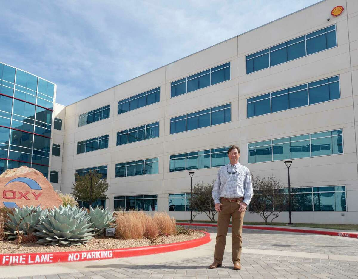 Kevin McMahon, General Manager of Shell US Shale Operations, stand under the new Shell logo put on the side of Oxy Permian Plaza 11/04/2020 afternoon after buying space on the first two floors. Tim Fischer/Reporter-Telegram