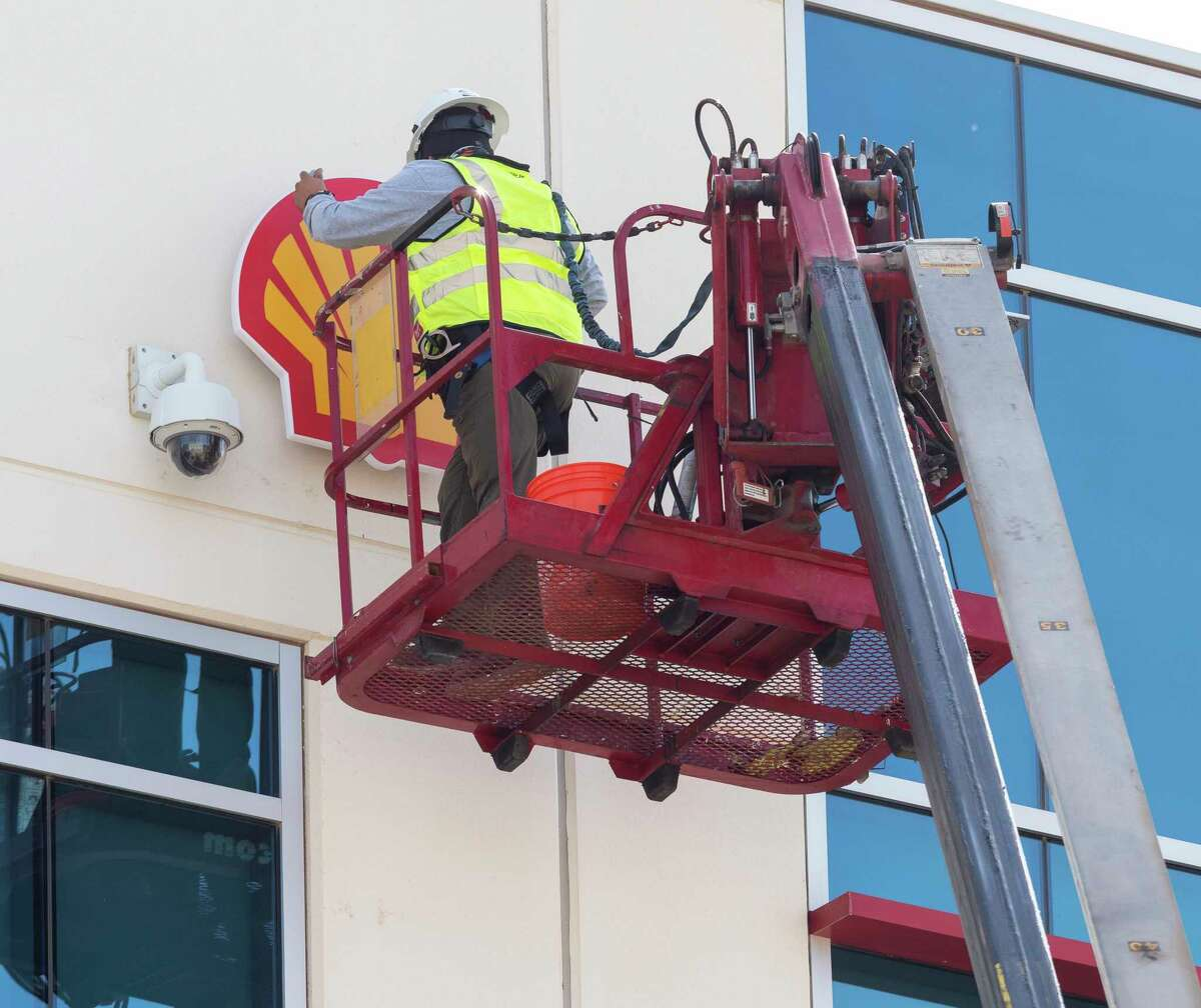 Jay Ramirez, lead tech with Cactus Sign installs the Shell logo on the side of Oxy Permian Plaza 11/04/2020 afternoon after Shell bought space on the first two floors. Tim Fischer/Reporter-Telegram