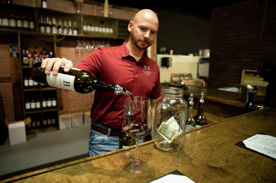 James Barber, president and founder of B.E. Winery pours himself a glass of Sagrantino, Friday, Oct. 30, 2020, in Conroe. Barber retired as an officer to open his own winery where he hoped to have as his last job. Photo: Gustavo Huerta, Houston Chronicle / Staff Photographer / 2020 © Houston Chronicle