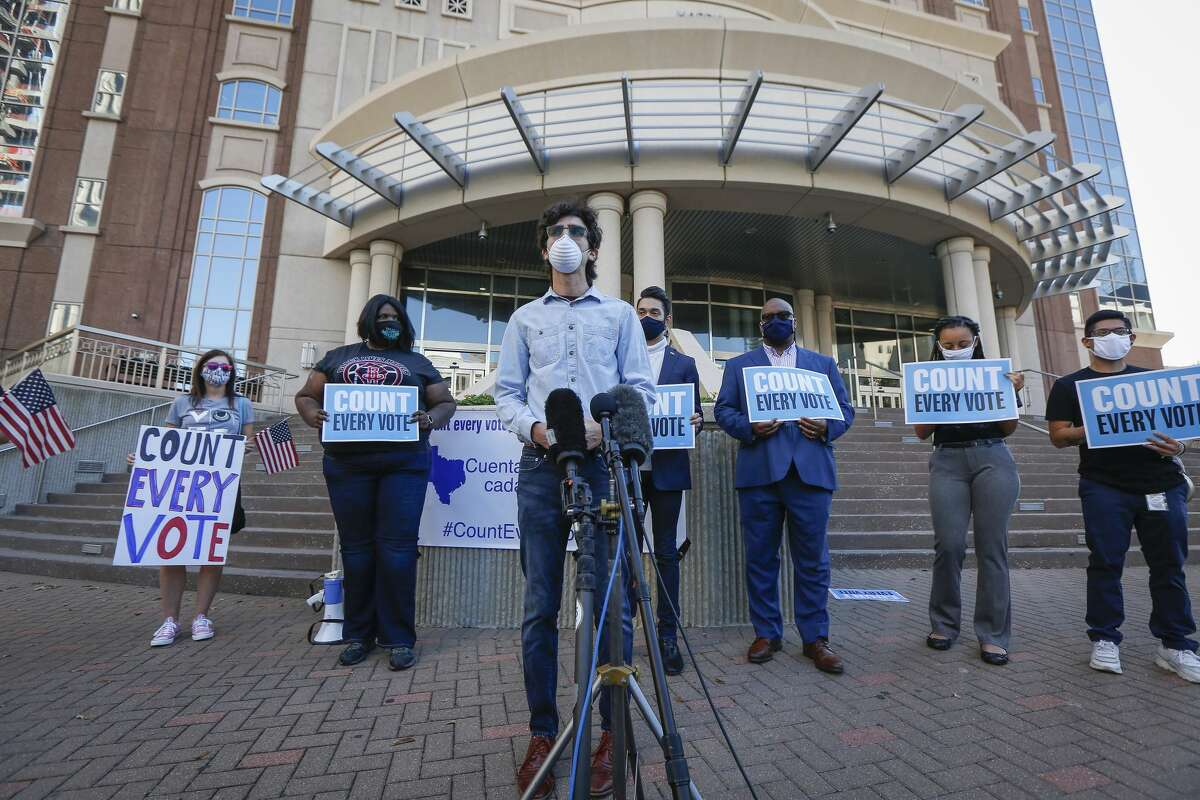 Daniel Cohen, president of Indivisible Houston joined voters, non-voters, and protectors of democracy, to make public statements in response to on-going election procedures at a press conference in front of the Harris County Clerk's Office Wednesday, Nov. 4, 2020, in Houston.