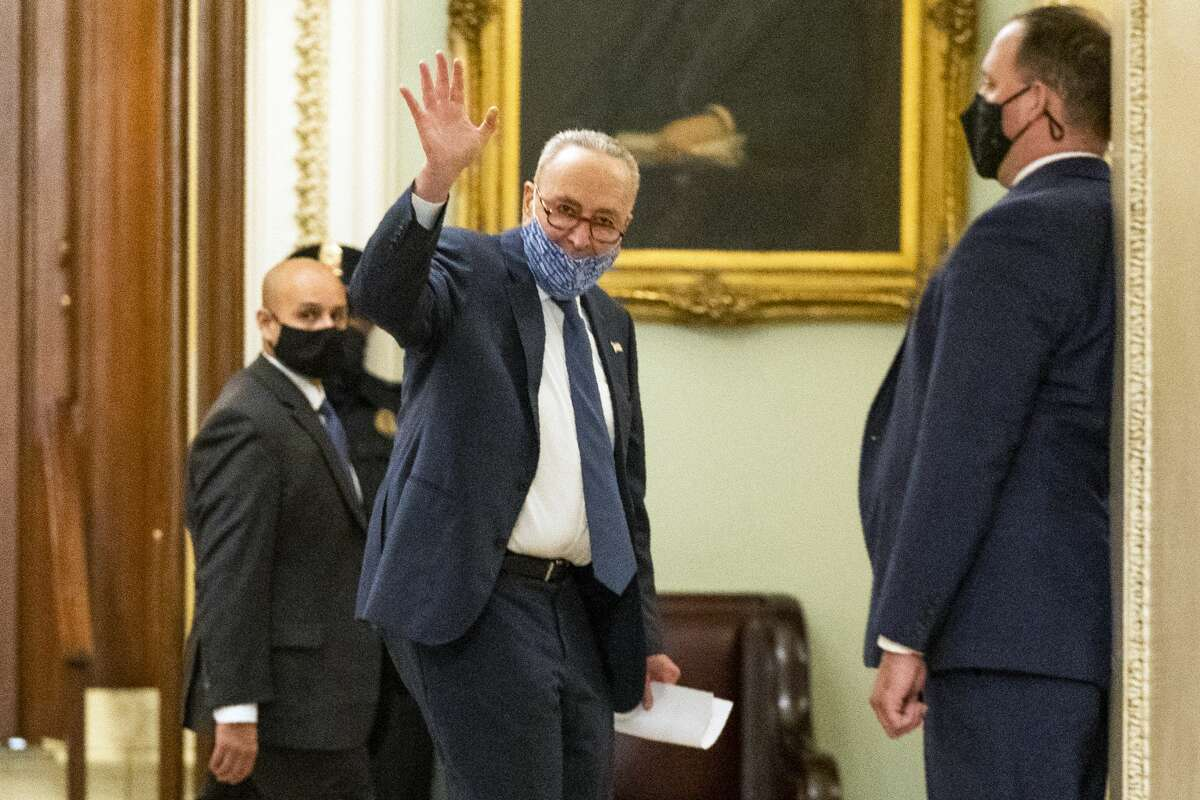 Senate Minority Leader Chuck Schumer of N.Y., waves as he leaves the chamber at the Capitol after a vote confirming Amy Coney Barrett to the Supreme Court, Monday, Oct. 26, 2020, in Washington. (AP Photo/Manuel Balce Ceneta)