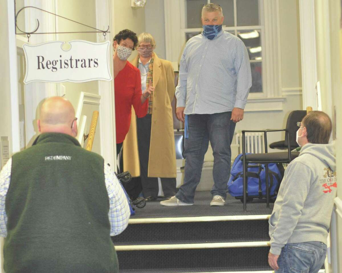 Election officials including Democratic Registrar Cindy Bruno, in red dress, and Republican Registrar Wayne Floegel, at top of stairs, worked late into election night. All the vote-counting and tabulating was finished up about 12:40 Wednesday morning.