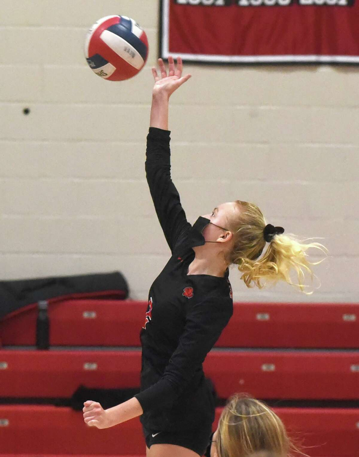 New Canaan's Elle Sneddon (2) goes up for a shot during a girls volleyball match against Greenwich in New Canaan on Thursday, Oct. 22, 2020.