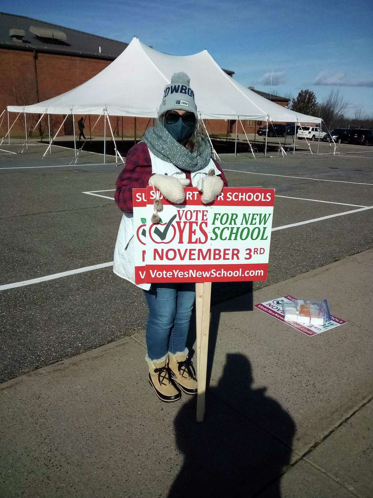 Torrington BOE member Susan DePritas stands outside Torrington Middle School Nov. 3, 2020, with a sign promoting the referendum on the school construction project, which was on the ballot.