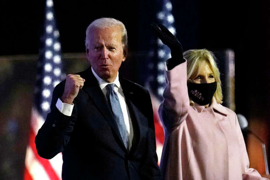 Democratic presidential candidate former Vice President Joe Biden arrives to speak to supporters, early Wednesday, Nov. 4, 2020, in Wilmington, Del., as Jill Biden looks on. Photo: AP Photo | Paul Sancya