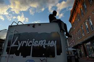 Dauda Mohamed Kanneh of Albany sits on top of the RV David Gordon transformed into a music studio to make his lyricism program mobile on Thursday, Oct. 1, 2020 in Albany, N.Y. Kanneh helps Gordon introduce youth to the program. (Lori Van Buren/Times Union)