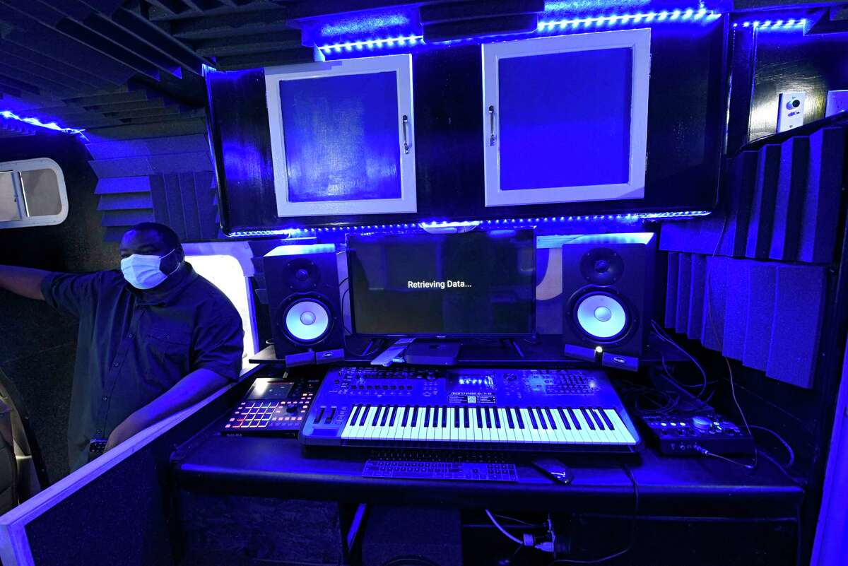 A sound board is seen in the RV David Gordon, left, transformed into a music studio to make his lyricism program mobile on Thursday, Oct. 1, 2020 in Albany, N.Y. (Lori Van Buren/Times Union)