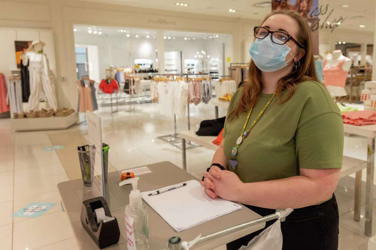 Katherine, an associate at Forever 21 in the Parkdale Mall stands at the door to remind customers to wear their masks properly in the store and offers them hand sanitizer if they'd like to use it. She has dealt with some customers who refused to conform to the store policy on face masks and reacted negatively. Photo made on June 28, 2020. Fran Ruchalski/The Enterprise