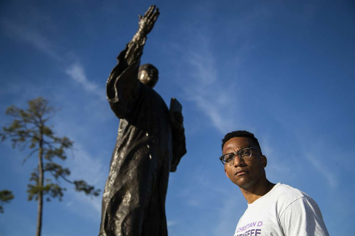 Newly elected as Harris County Attorney Christian Menefee by the statue of Martin Luther King Jr. at McGregor Park everyday, Wednesday, Nov. 4, 2020, in Houston.