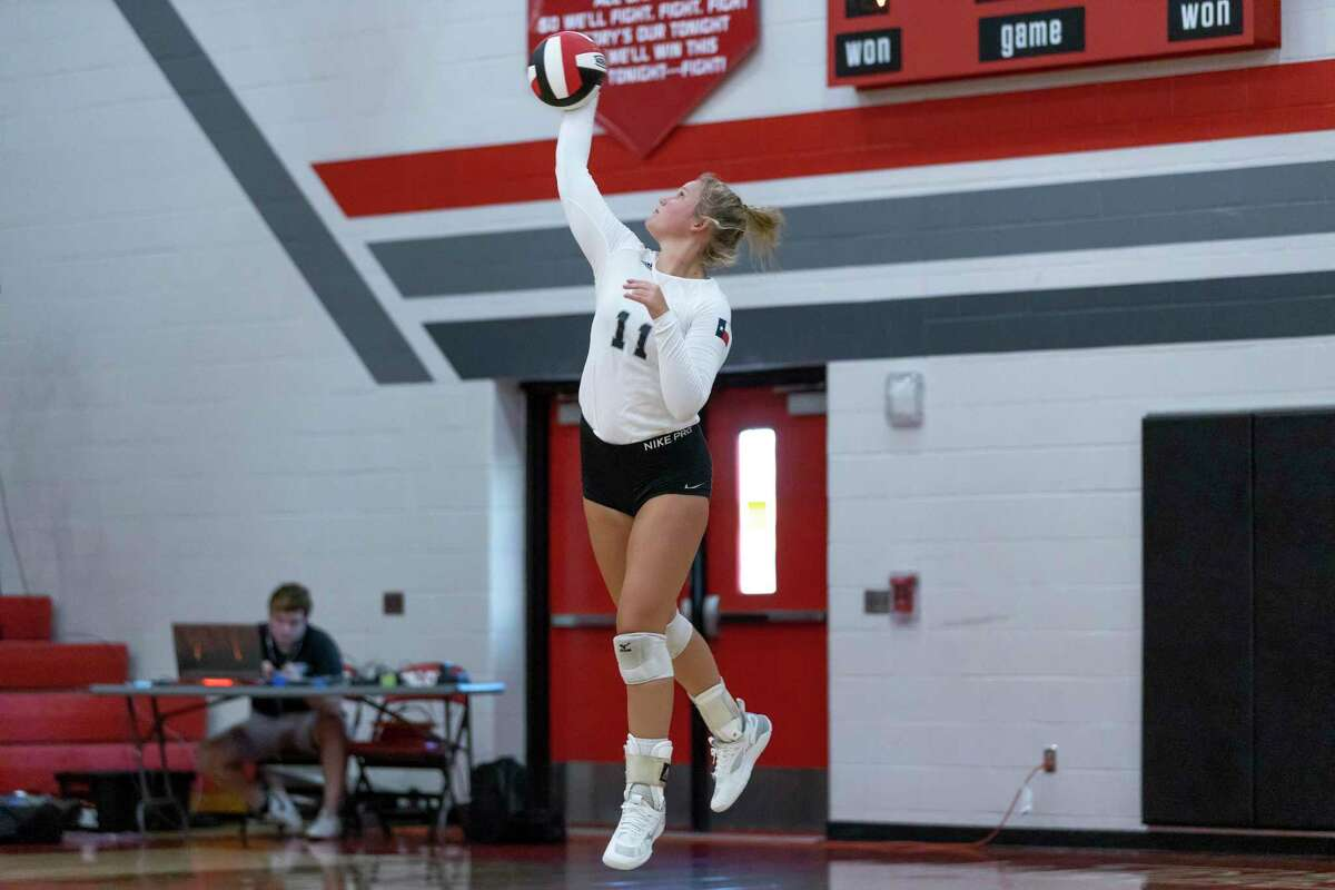Brenna Jones (11) of Hargrave serves during the third set of a non-district high school volleyball match at Hargrave High School in Huffman, Tuesday, August 11, 2020.