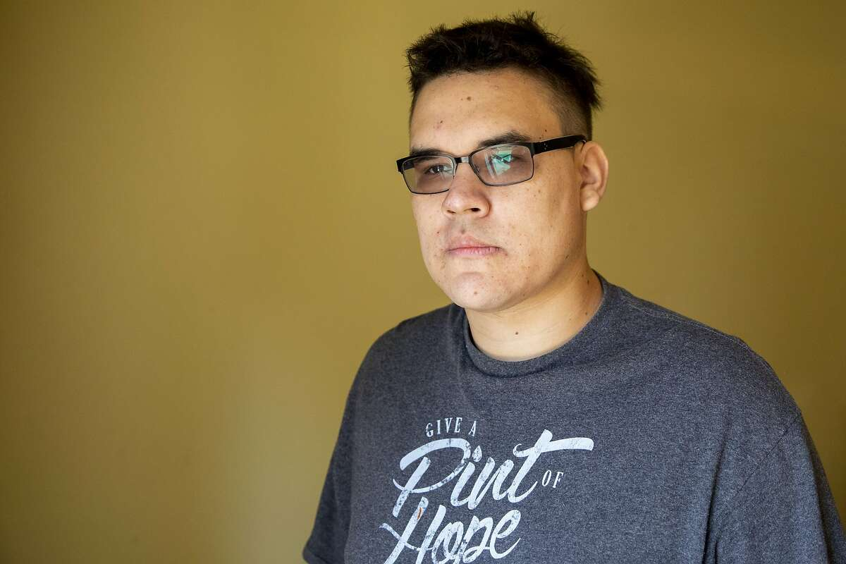 Michael Alexander poses for a portrait at his mother's partner's home in Marysville on October 29, 2020. Alexander was accused of murdering his neighbor Leola Shreves in 2013 and served over three years in prison, but DNA evidence revealed another man, Armando Cuadras, as the killer.