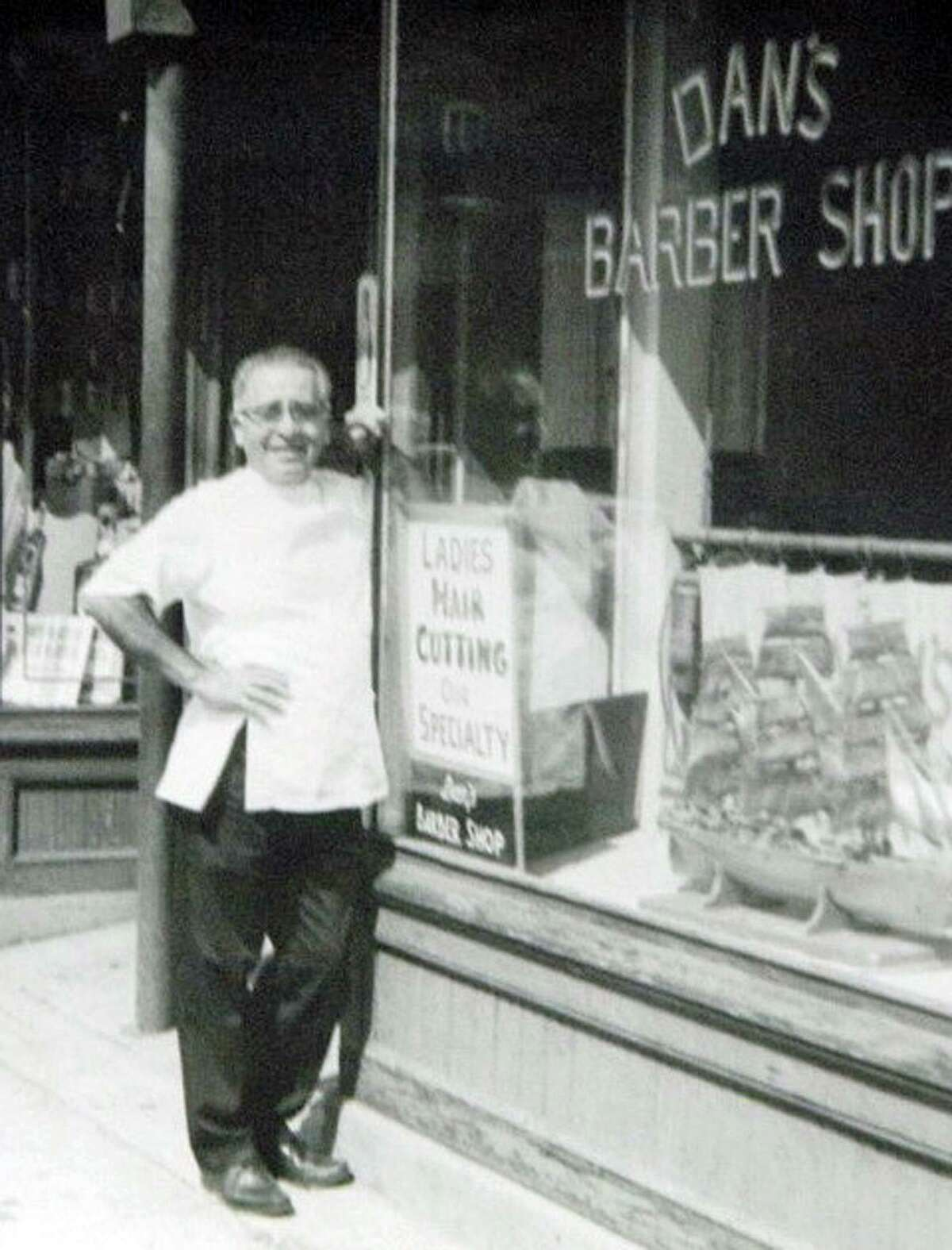 The Singing Barber, Dan Masto, Sr., in front of his barber shop in Wooster Square
