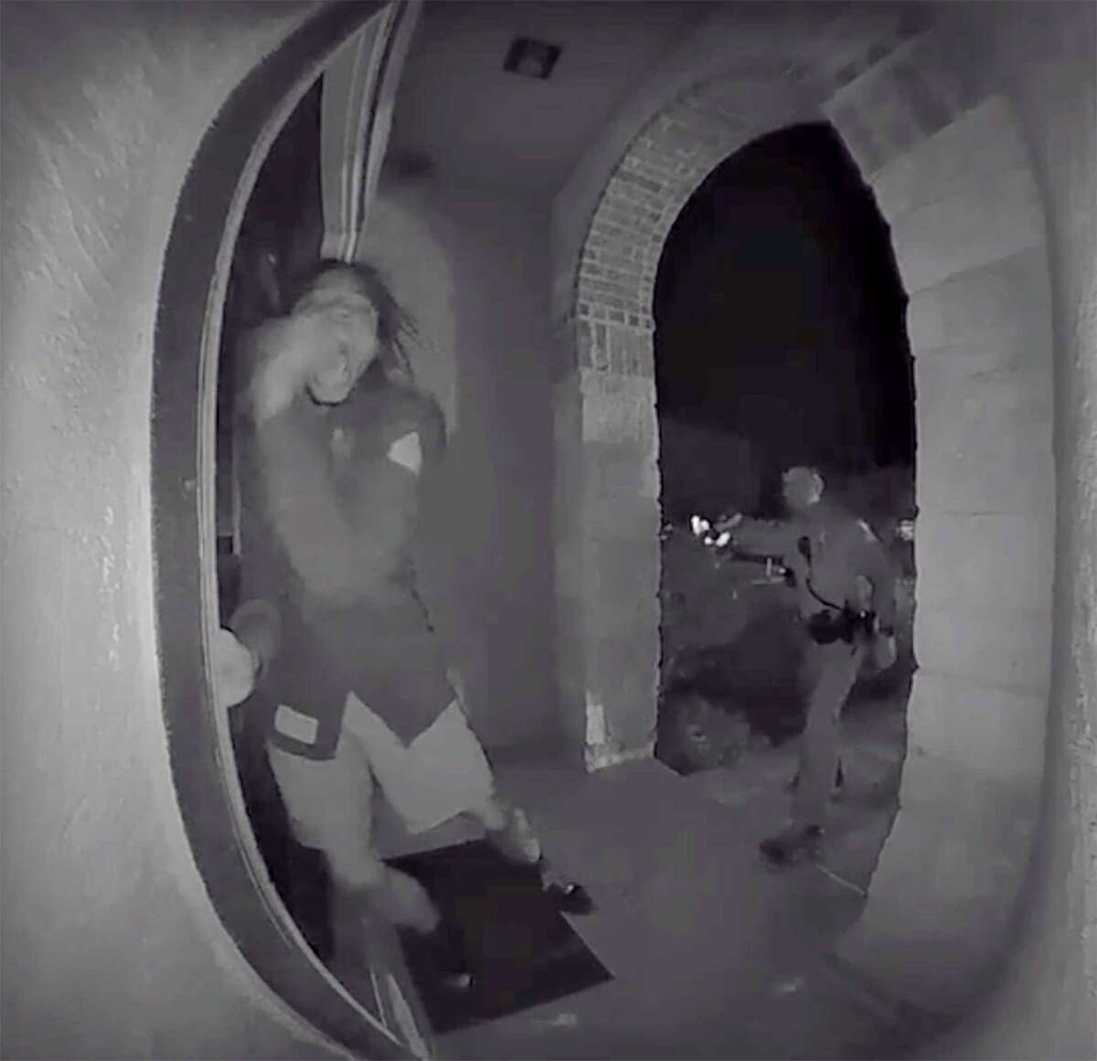 A screen grab from a home surveillance video shows a Schertz police officer using a Taser on Zekee Rayford, 18, as he pounds on the front door of his home while calling for his parents. Police said he ran a red light and failed to pull over.