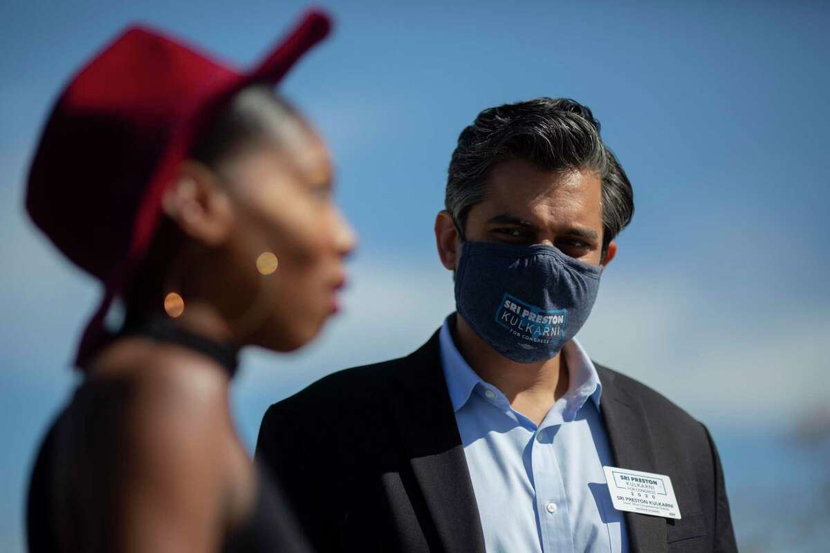 Democrat Sri Kulkarni, right, listens to voter Destiny Ilori, left, after she submitted her vote at a polling site on Tuesday, Nov. 3, 2020, in Houston. Kulkarni lost his bid for Texas' 22nd Congressional District to Republican Fort Bend County Sheriff Troy Nehls.