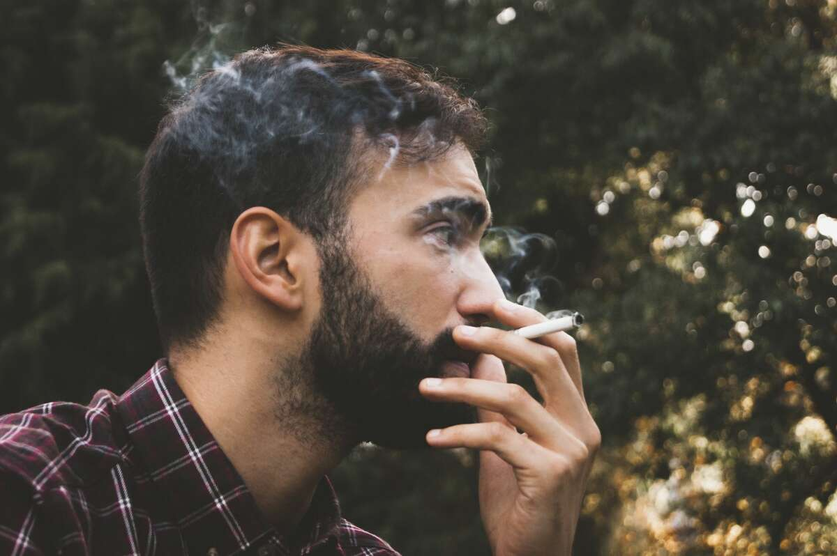 A couple wants a neighbor to stop smoking outside.
