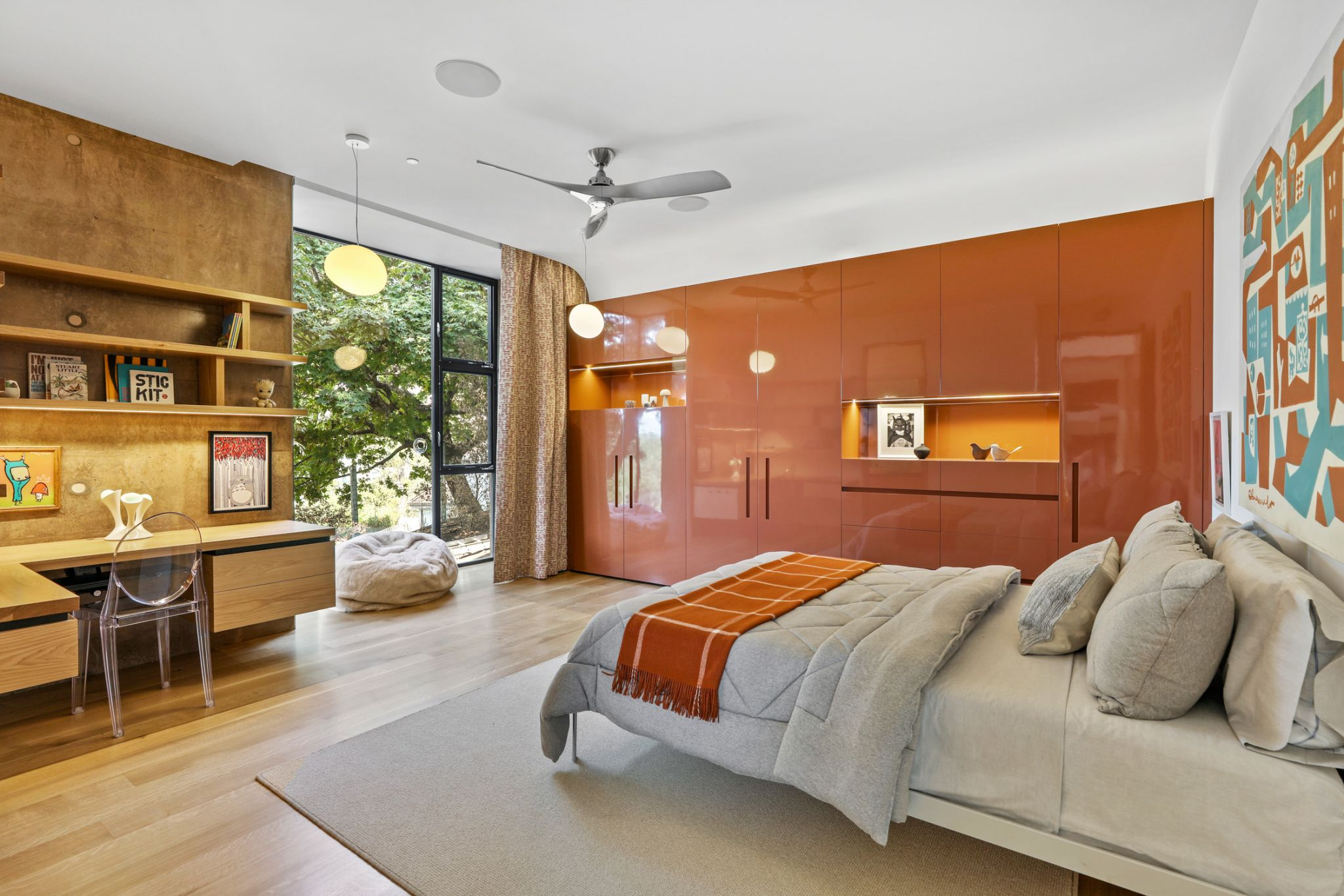 The primary bedroom with its private deck showcases custom hickory closet cabinetry.
