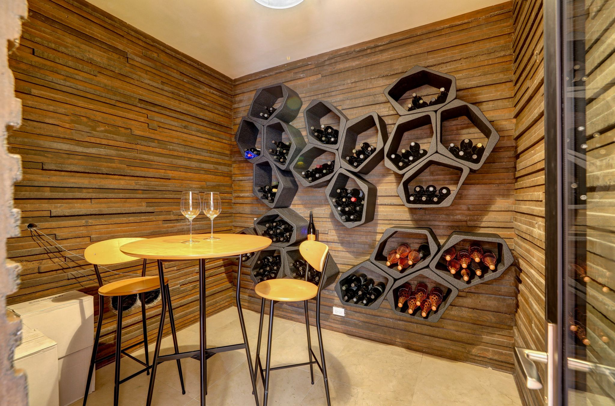 A home like this would not be complete without a wine cellar and tasting space.