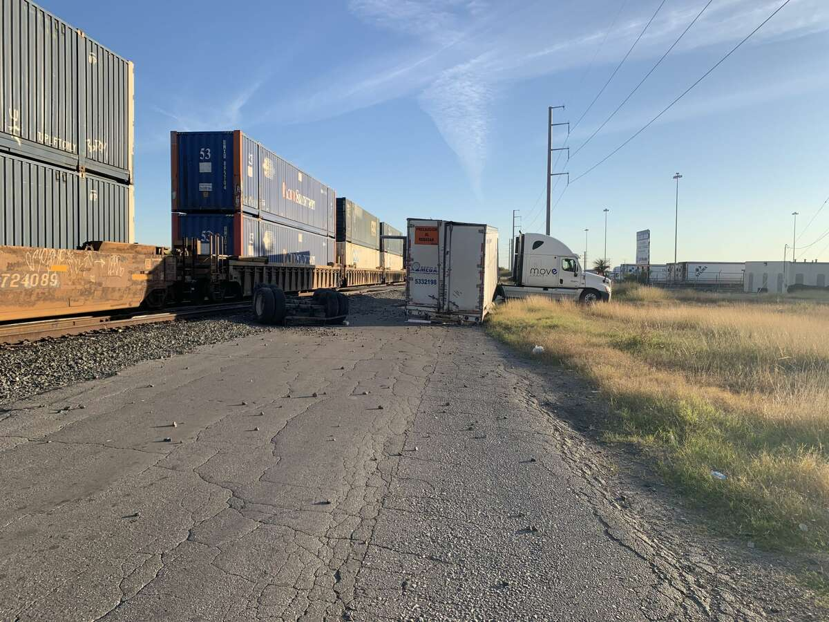 An 18-wheeler carrying Whataburger cups was struck by a train Wednesday, according to San Antonio police. The incident occurred near the Rittiman Plaza industrial park on the Northeast Side shortly after 4 p.m. An 18-wheeler carrying Whataburger cups was struck by a train Wednesday, according to San Antonio police. The incident occurred near the Rittiman Plaza industrial park on the Northeast Side shortly after 4 p.m.