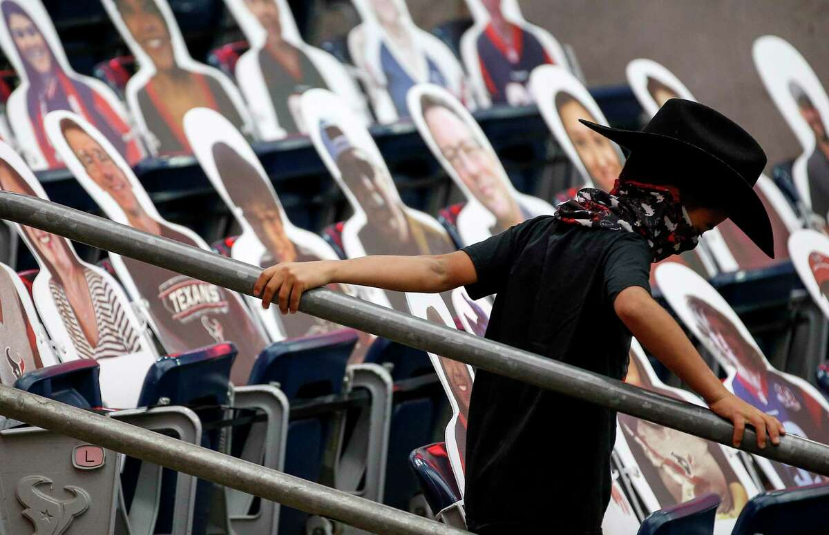 A young fan Houston Texans fan walks towards the field before an NFL game Sunday, Oct. 25, 2020, at NRG Stadium in Houston.