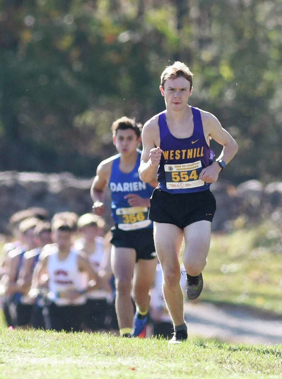 Westhill's Colin McLaughlin won the FCIAC West Region championship on Wednesday at Waveny Park in New Canaan. McLaughlin finished with a time of 15:37.