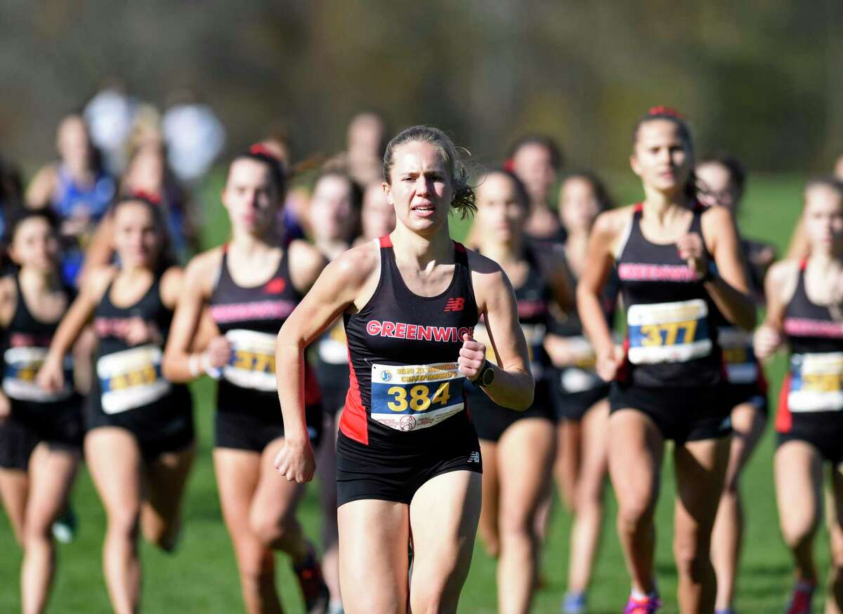 Greenwich's Mari Noble competes in the FCIAC girls cross country championship West Region heat on Wednesday at Waveny Park in New Canaan. Noble finished first overall for girls with a time of 14:26.