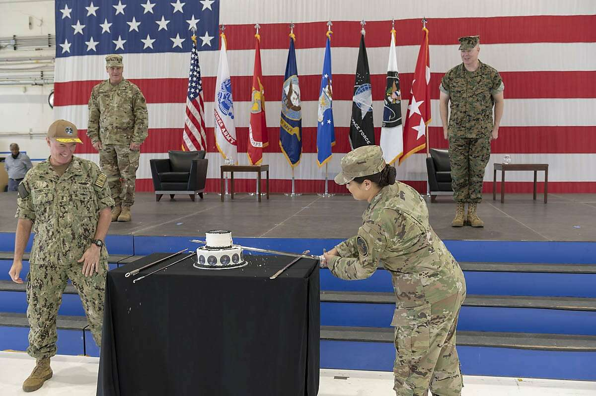 U.S. Air Force Staff Sgt. Kiara Kashner, right, and U.S. Navy Rear Adm. Michael Bernacchi, representing U.S. Space Command's longest-serving and junior-serving members, respectively, cut a cake in honor of the combatant command's first birthday Aug. 28, 2020, at Peterson Air Force Base, Colorado.