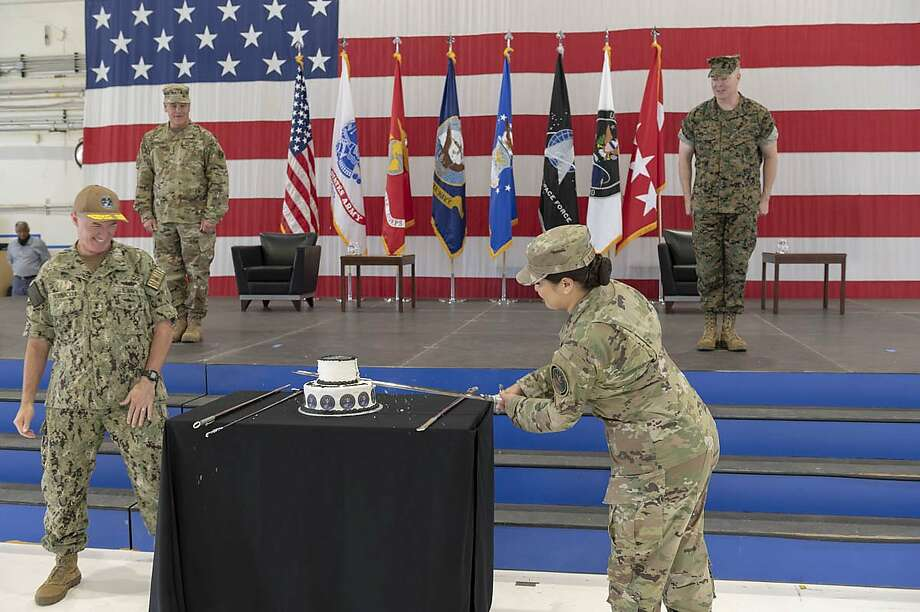 U.S. Air Force Staff Sgt. Kiara Kashner, right, and U.S. Navy Rear Adm. Michael Bernacchi, representing U.S. Space Command's longest-serving and junior-serving members, respectively, cut a cake in honor of the combatant command's first birthday Aug. 28, 2020, at Peterson Air Force Base, Colorado. Photo: Lewis Carlyle, U.S. Space Command Public Affairs