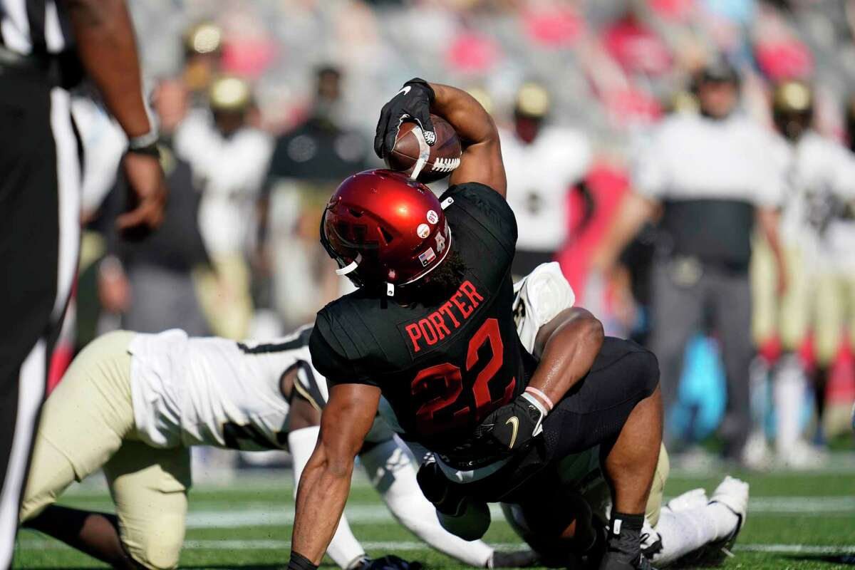 Kyle Porter (22), the only UH running back with more rushing yards than quarterback Clayton Tune, is halted during Saturday's 44-21 loss to Central Florida.