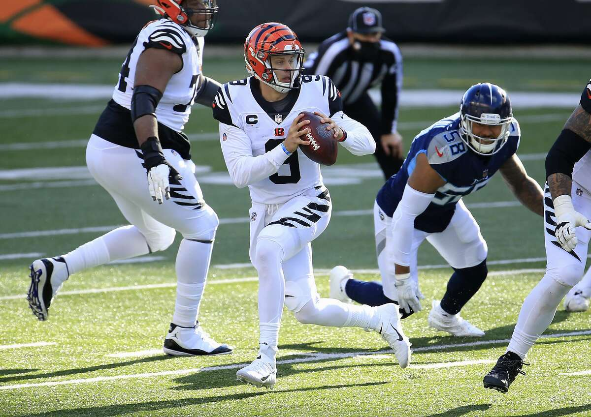 The Bengals' Joe Burrow looks to pass against the Titans in a victory on Sunday. While the Bengals (2-5-1) are barren in so many areas, Burrow looks exactly like a franchise QB.