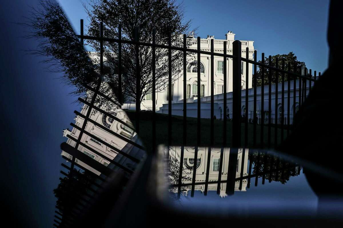 The north side of the White House is reflected in a screen during sunset on Wednesday, Nov. 4, 2020.