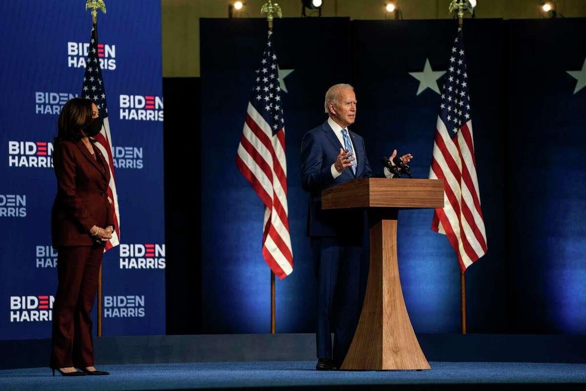 Former vice president Joe Biden addresses supporters as Sen. Kamala Harris, D-Calif., listens at the Chase Center in Wilmington, Del., on Wednesday, Nov. 4, 2020.