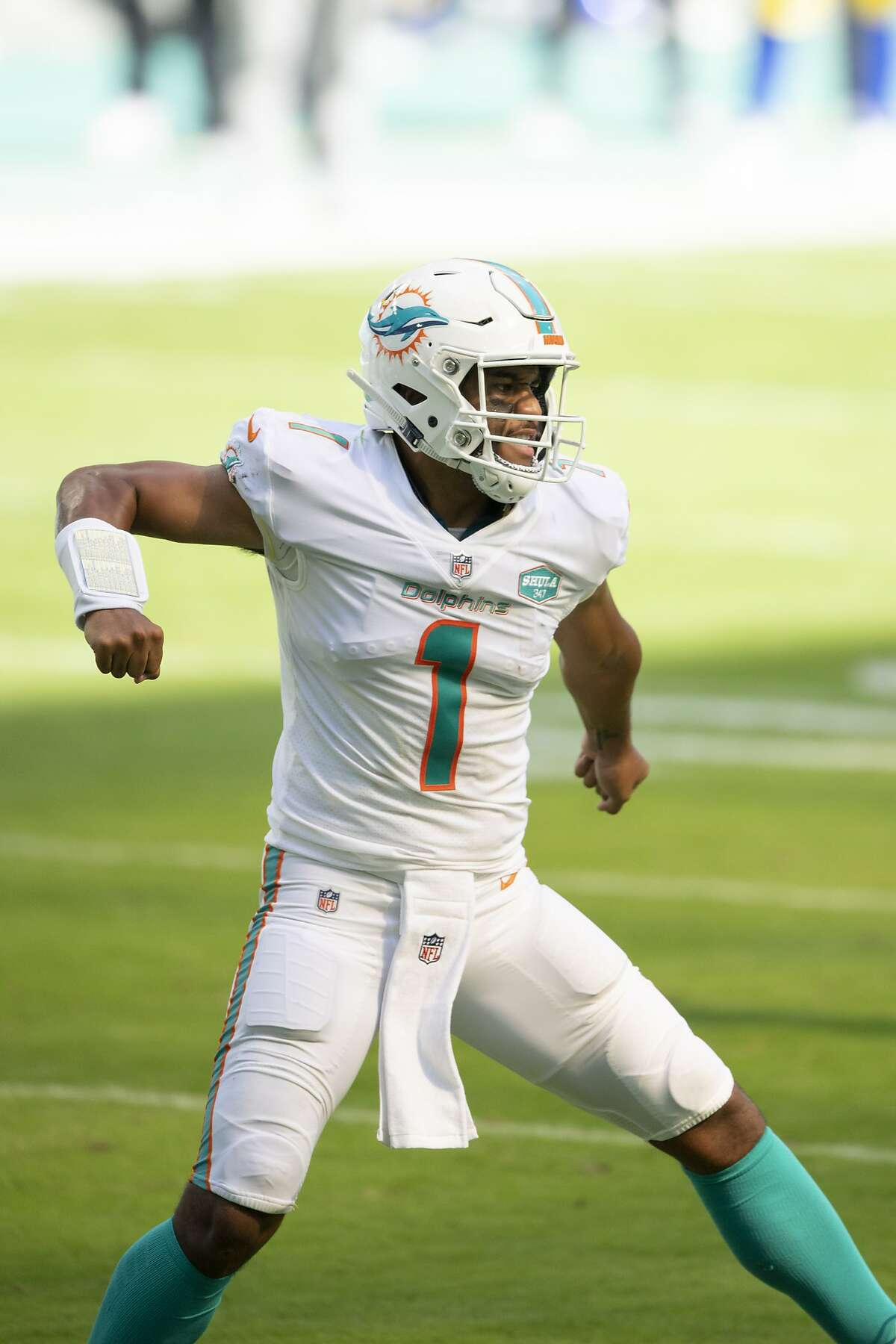 The Dolphins' Tua Tagovailoa celebrates his first career TD pass, to wide receiver DeVante Parker, against the Rams.
