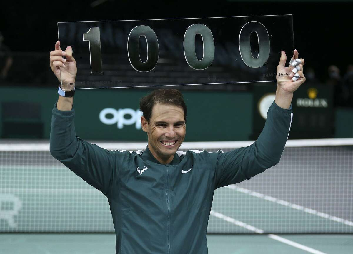 Rafael Nadal of Spain celebrates his 1000th match victory at the Paris Masters. Nadal's first win came in May 2002 at the age of 15.