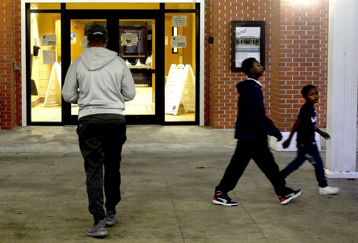 Neighborhood children walk past as the last of Super Tuesday voters make their way to the polls at Alice Keith Park in Beaumont.. Photo taken Tuesday, November 3, 2020 Kim Brent/The Enterprise