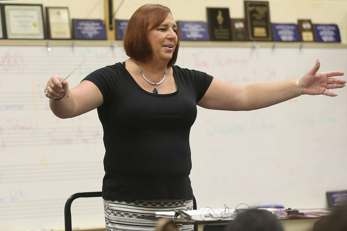Stephanie Byers, conducting a band class at Wichita North High School, became Kansas' first openly transgender elected official.