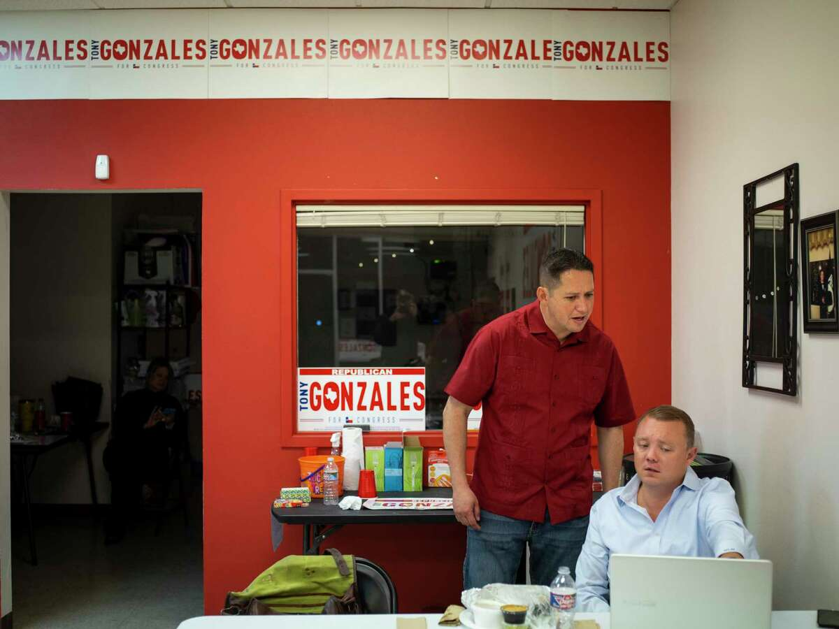 Tony Gonzales, second right, who is running for Congressional seat for District 23, talks with campaign consultant Matt Mackowiak about results during an election night event on Tuesday, November 3, 2020 in San Antonio, Tx., U.S.