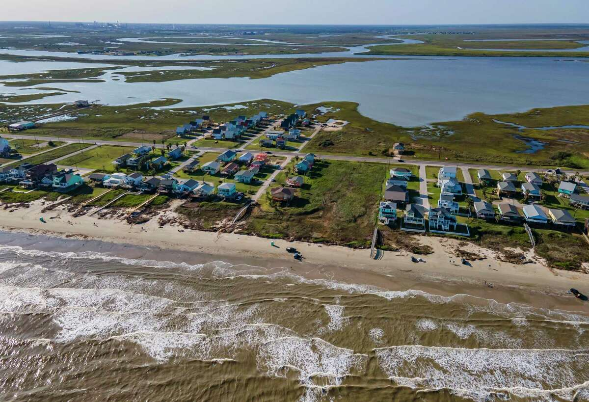 A piece of commercial property owned by Melinda Wilhelm sits vacant where Enterprise and Enbridge want to build a pipeline in Surfside, TX, Friday, Oct. 2, 2020. Wilhelm refused to sell the property to the company, and is banding together with the city of Surfside and other residents to oppose the pipeline that would allow crude oil to travel across Follet's Island to an offshore terminal where the oil could be exported directly into waiting tankers. Residents are worried about possible impacts to the environment and the aquifer that the city relies on for their water supply.