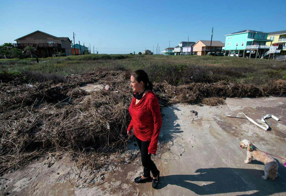 Melinda Wilhelm looks at the property she owns where Enterprise and Enbridge want to build a pipeline in Surfside, TX, Friday, Oct. 2, 2020. Wilhelm refused to sell the property to the company, and is banding together with the city of Surfside and other residents to oppose the pipeline that would allow crude oil to travel across Follet's Island to an offshore terminal where the oil could be exported directly into waiting tankers. Residents are worried about possible impacts to the environment and the aquifer that the city relies on for their water supply.