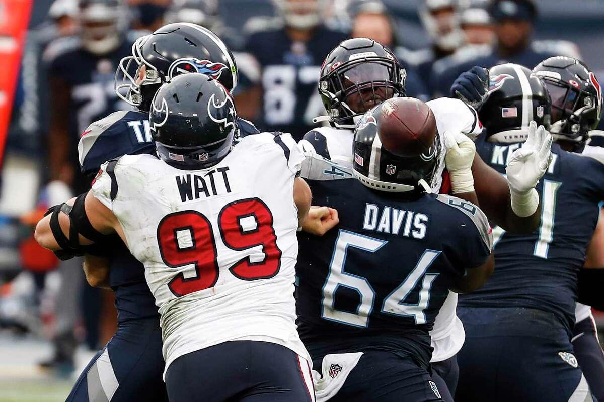 Texans defensive end J.J. Watt (99) sacks Titans quarterback Ryan Tannehill, forcing a fumble and a turnover.