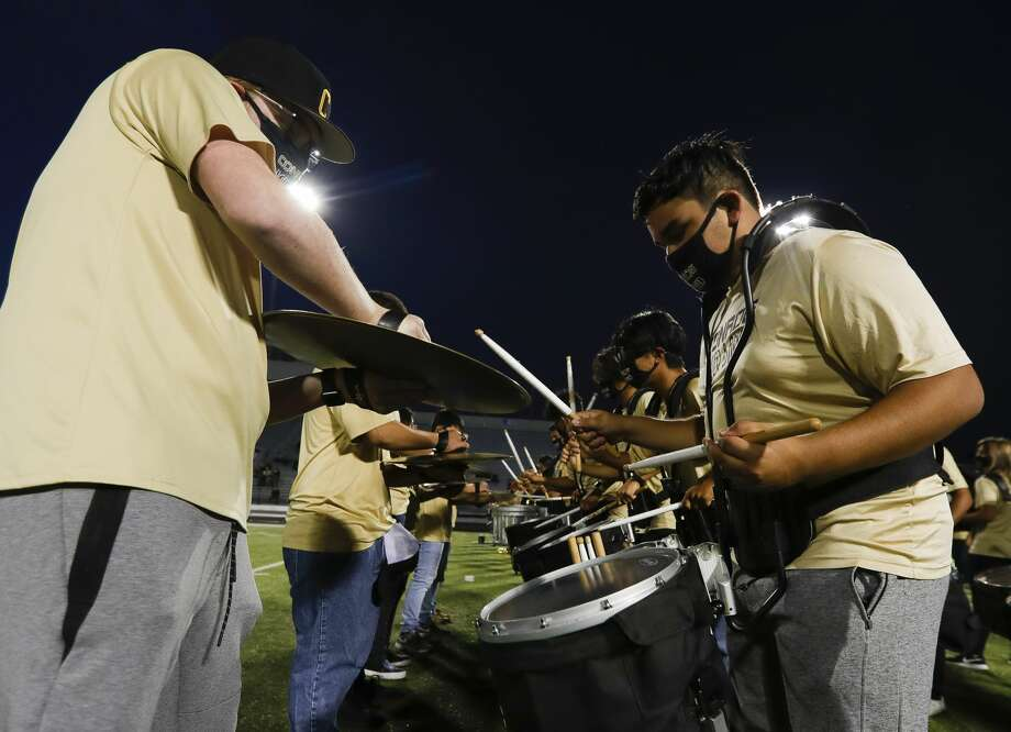 Conroe drummer Anthony Gutierrez performs for the crowd during Conroe High School's homecoming pep rally at Buddy Moorehead Stadium, Wednesday, Nov. 4, 2020, in Conroe. Photo: Jason Fochtman/Staff Photographer