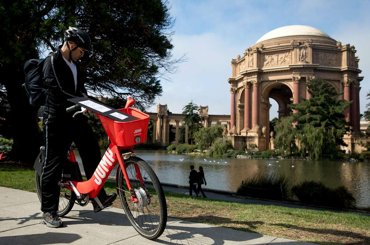 San Francisco Chronicle reporter Peter Hartlaub stops on his JUMP bike to take a picture of the Palace of Fine Arts as he and fellow reporter Heather Knight attempt to traverse San Francisco's 49-mile Scenic Drive without using a car.