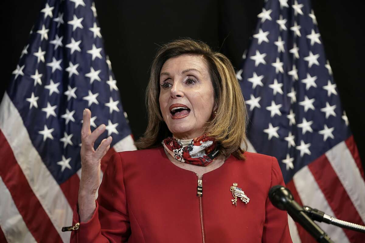 Speaker of the House Nancy Pelosi speaks to reporters at Democratic National Committee headquarters on Capitol Hill on Tuesday.