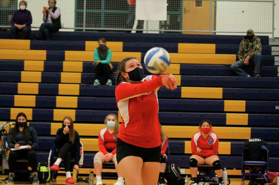 Kaya Watkins makes a pass to keep the volley alive for the Sabers in the district semifinals on Nov. 4. (Photo/Robert Myers)