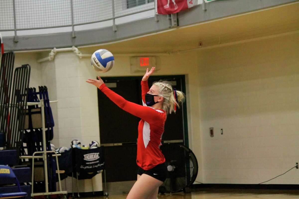 Josie Ziehm serves the ball for Manistee Catholic during the Sabers loss to Brethren on Nov. 4. (Photo/Robert Myers)