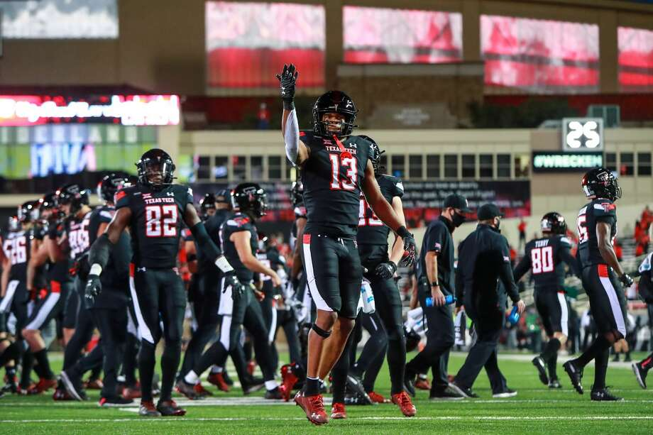LUBBOCK, TEXAS - OCTOBER 31: Receiver Erik Ezukanma #13 of the Texas Tech Red Raiders gestures after a touchdown during the first half of the college football game against the Oklahoma Sooners at Jones AT&T Stadium on October 31, 2020 in Lubbock, Texas. (Photo by John E. Moore III/Getty Images) Photo: John E. Moore III/Getty Images / 2020 John E. Moore III