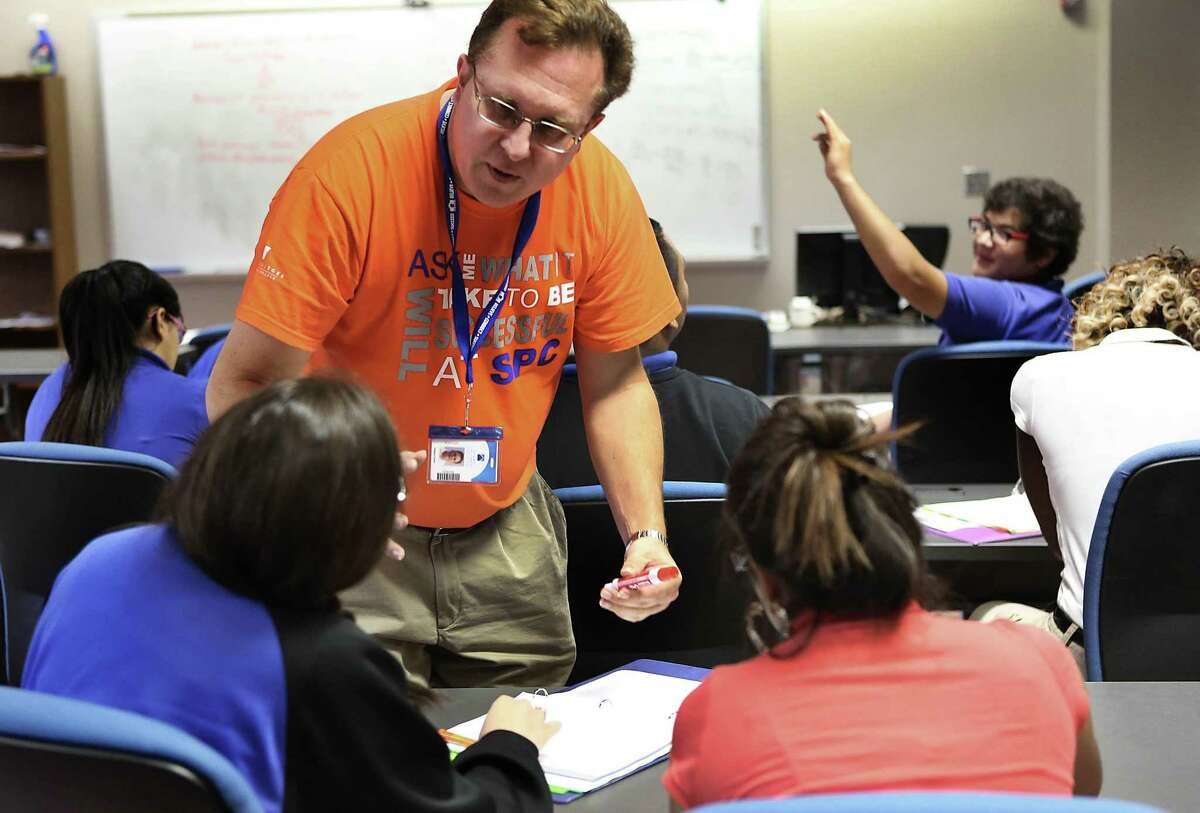 Greg Graue, Algebra 1 AP teacher at St. Philip's Early College High School, answers questions during a class in the Bowden Building at the college campus in 2014.