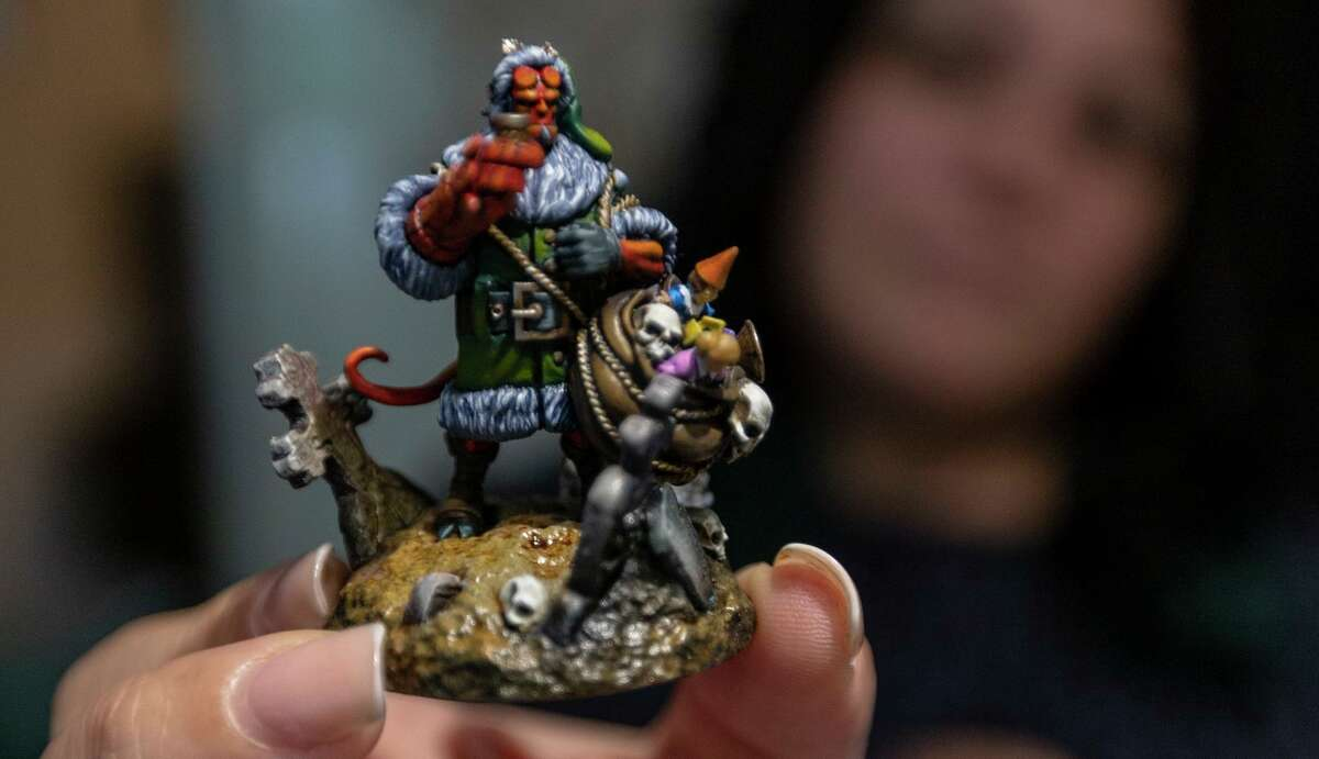 Lyn Stahl displays a completed figure she made as part of her Metalhead Minis business she started in 2009. Stahl takes commissions which can cost into the thousands of dollars and take hundreds of hours to complete in addition to offering online and in-person painting classes.