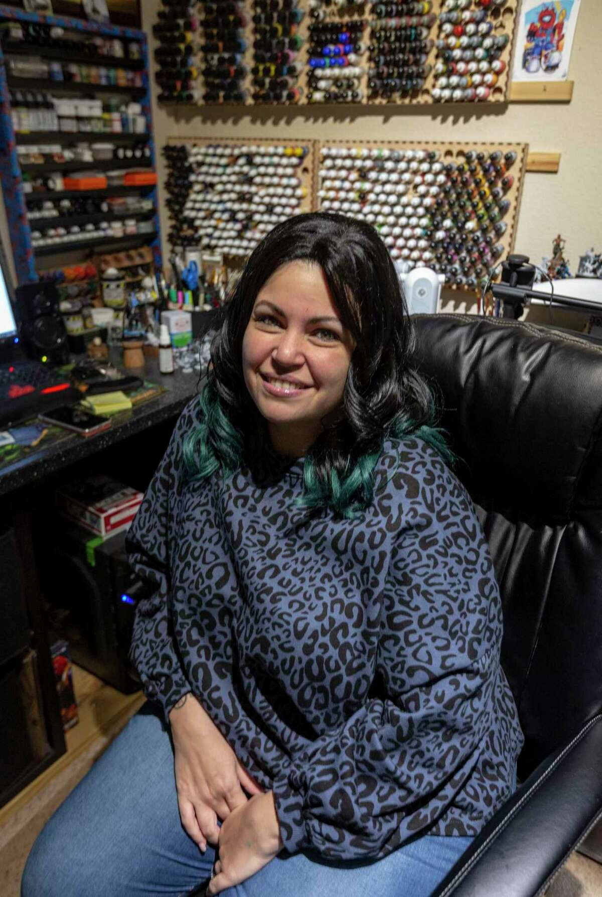 Lyn Stahl in her home office in San Antonio where she operates Metalhead Minis, a business she started in 2009 to paint miniature Dungeons & Dragons figures and other tabletop gaming miniatures for players and collectors.
